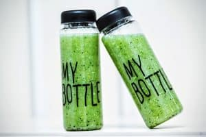 two bottles with smoothie