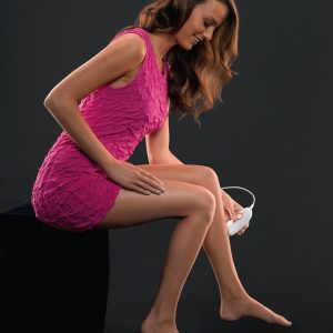 girl using an epilator on her legs