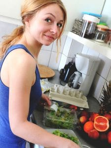 lady preparing fruits and vegetables for juicer